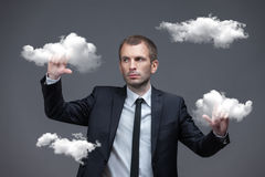 Businessman pushes virtual cloud buttons Royalty Free Stock Photo