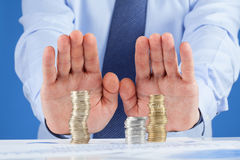 Businessman pushing away column from euro coins Royalty Free Stock Photo