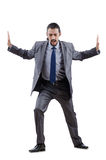 Businessman pushing away virtual obstacles Royalty Free Stock Images
