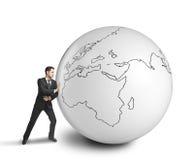 Businessman pushing big ball Stock Photography