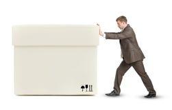 Businessman pushing big white box Royalty Free Stock Image
