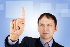 Businessman pushing on a button Stock Image