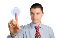 Businessman pushing a button Stock Images