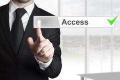 Businessman pushing button access Stock Photos