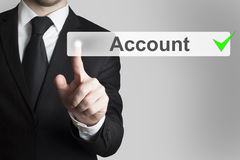 Businessman pushing button account Royalty Free Stock Photos