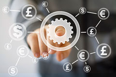 Businessman pushing button engineering with dollar eur web currency Royalty Free Stock Images