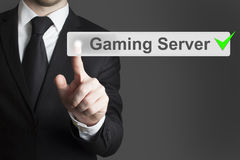 Businessman pushing button gaming server checked Royalty Free Stock Photo