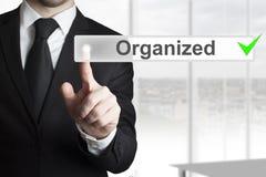 Businessman pushing button organized Royalty Free Stock Image