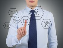 Businessman pushing button. On virtual touch screen Stock Photography