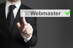 Businessman pushing button webmaster Stock Photography