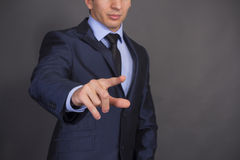 Businessman pushing a button Royalty Free Stock Image