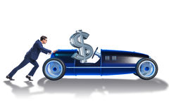 The businessman pushing car with dollar in driving seat Royalty Free Stock Images