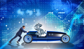 The businessman pushing car with dollar in driving seat Stock Image