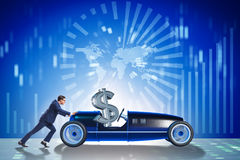 The businessman pushing car with dollar in driving seat Royalty Free Stock Photos