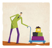 Businessman pushing a cart with house and boxes Royalty Free Stock Photo