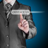 Businessman pushing CONTACT US sign Stock Photos