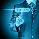 Businessman pushing CONTACT US sign Stock Images