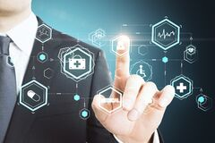 Businessman pushing creative glowing medical interface hud hologram