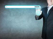 Businessman pushing digital searching button. royalty free stock image