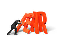 Businessman pushing domino of red fear word falling Royalty Free Stock Image