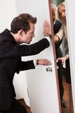 Businessman pushing the door Stock Images