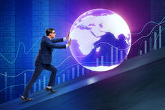 The businessman pushing earth in business concept Stock Photography