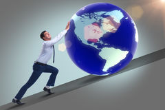 The businessman pushing earth in business concept Stock Image