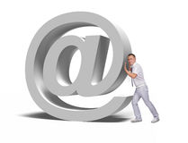 Businessman pushing email symbol Royalty Free Stock Photo