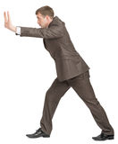 Businessman pushing empty space Stock Images