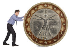 Businessman pushing euro coin Royalty Free Stock Photo