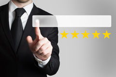 Businessman pushing flat button five rating stars Stock Image