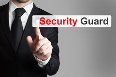 Businessman pushing flat button security guard Royalty Free Stock Photos