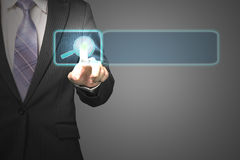 Businessman pushing on future touch screen with magnifier icon i. N space for searching in dark background Stock Images