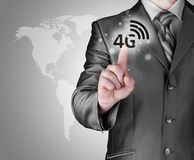 Businessman pushing 4g. This image has attached release Royalty Free Stock Photos