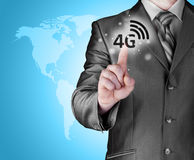 Businessman pushing 4g Stock Images