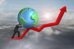 Businessman pushing globe upward at starting point of trend line. Businessman pushing globe upward at starting point of red trend line with sunlight cloudscape royalty free stock photos