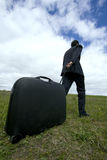 Businessman pushing his baggage Royalty Free Stock Images