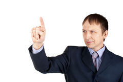Businessman pushing an imaginary button Royalty Free Stock Photos