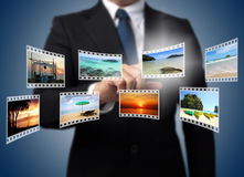 Businessman pushing many image in film button Stock Photography