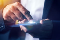 Businessman pushing mobile phone touch screen. Selective focus Stock Photo