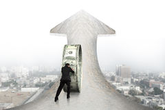 Businessman pushing money circle on arrow marble road with citys Royalty Free Stock Image