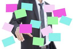 Businessman pushing paper note on the whiteboard. Royalty Free Stock Photos