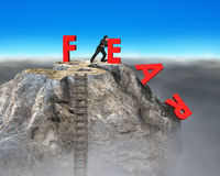 Businessman pushing red fear word down with dollar sign. And wooden ladder on top of rocky mountain, overcoming fear concept stock illustration