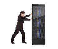 Businessman pushing server rack Royalty Free Stock Images