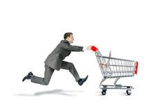 Businessman pushing shopping cart Royalty Free Stock Photos
