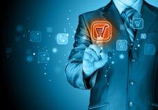 Businessman pushing shopping cart Stock Images