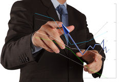 Businessman  pushing solution graph on a touch screen interface Stock Image
