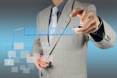 Businessman  pushing solution graph on a touch screen interface Royalty Free Stock Photo