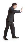 Businessman is pushing something Royalty Free Stock Image