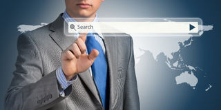 Businessman pushing on a touch screen Royalty Free Stock Image